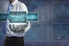 Man with 3D robot hand interacting with medical interfaces Stock Photo