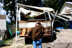 Man and damaged rv Stock Photography