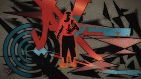 A man dances with graffiti spraying onto the wall behind him stock video