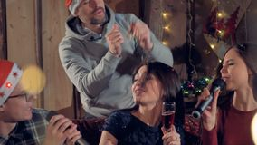 A man dances and throws Christmas confetti. stock footage