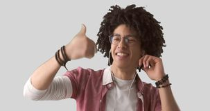 Man dancing while listening music on headphones. Over white background stock footage