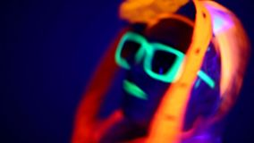 Man is dancing in neon clothes close up stock footage