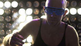 Man dancing at the party wearing neon led glasses stock footage