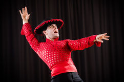 The man dancing spanish dance in red clothing Stock Photo