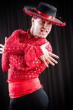 The man dancing spanish dance in red clothing Stock Photos