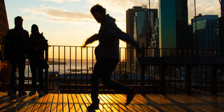 Man dancing on terrace Stock Images
