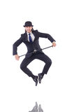 Man dancing with walking stick Royalty Free Stock Photo