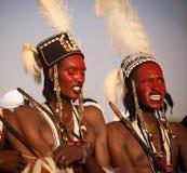 Man dancing Yaake dance and sing at Guerewol festival in InGall village, Agadez, Niger. Man dancing Yaake dance and sing at Guerewol festival - 23 september 2017 Stock Photos