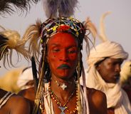 Man dancing Yaake dance and sing at Guerewol festival in InGall village, Agadez, Niger. Man dancing Yaake dance and sing at Guerewol festival - 23 september 2017 stock photography