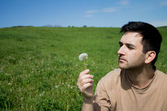 Man with dandelion Royalty Free Stock Image