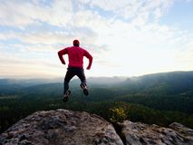 Man dangerously jumping on the edge. Man jump. Young man falling down Stock Photos