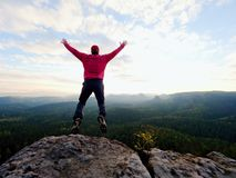 Man dangerously jumping on the edge. Man jump. Young man falling down Royalty Free Stock Photo