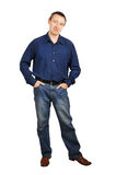 Man in a dark blue shirt and dark blue jeans Royalty Free Stock Photo