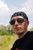 Man in dark glasses and a bandana on his head Stock Photography