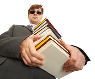 Man in dark glasses holding a books Stock Images