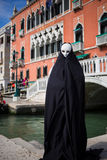Man in dark halloween like costume. On streets of Venice during carnival Stock Photography
