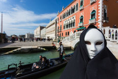 Man in dark halloween like costume. On streets of Venice during carnival Royalty Free Stock Photography