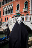 Man in dark halloween like costume. On streets of Venice during carnival Royalty Free Stock Images