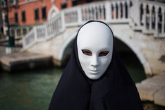 Man in dark halloween like costume. On streets of Venice during carnival Stock Photo