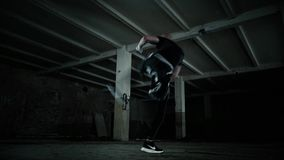 Man in dark practice martial art - stretching. Fitness kickboxing stock video