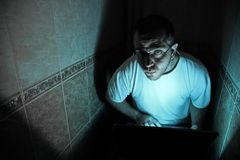 Man with in a dark room Stock Photos