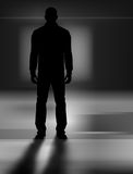 Man in the dark. Vector illustration of a man standing in a dark scenery Royalty Free Stock Photography