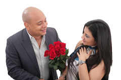 Man dating a girl giving a bouquet of flowers Stock Photography