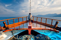 Man day-deaming on traditional Greek ship Stock Photos