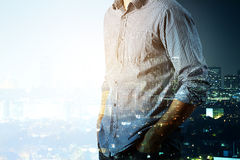 Man in day and nigth city. Side view of man on abstract day and night city background. Double exposure. Copy space Royalty Free Stock Photography