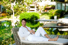 Man On Daybed Royalty Free Stock Photography