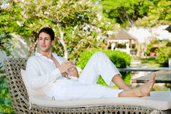 Man On Daybed stock photography