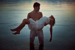 Man with dead lover in lake waters Royalty Free Stock Photos
