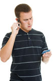 Man with a debit card. On a white background royalty free stock photography