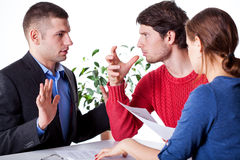 Man deceived by insurance agent. Man beeing angry with insurance agent who deceived him Stock Photography