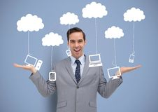 Man deciding or choosing computers phones and tablet devices hanging from clouds with open palms han Royalty Free Stock Image