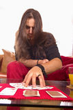 Man with a deck of cards on the table in game Royalty Free Stock Photos