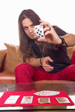 Man with a deck of cards on the table Stock Image