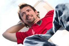 Man on a deckchair Stock Photography