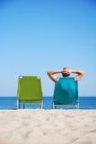 Man on deckchair at the beach Royalty Free Stock Photos
