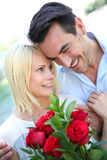 Man declaring his love with red roses Stock Photo
