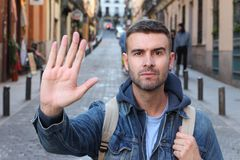 Man declining with a hand gesture.  stock image