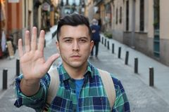 Man declining with a hand gesture stock images