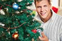 Man by decorated tree Stock Photography