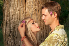 Man decorates hair of beautiful blonde Royalty Free Stock Photography