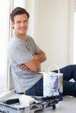 Man decorating house Stock Photo