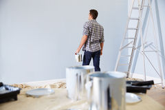 Man Decorating Nursery For New Baby Stock Image