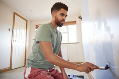 Man Decorating Room In New Home Painting Wall stock image