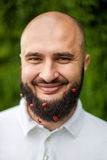 Man with decoration in beard Royalty Free Stock Photos