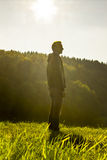 Man deep breathing in nature. Sunlight royalty free stock images