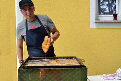 Man deep-fried schnitzel stock image